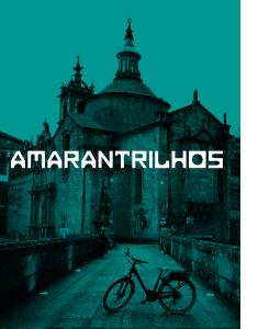 Bicicleta na ponte de São Gonçalo com a Igreja de fundo